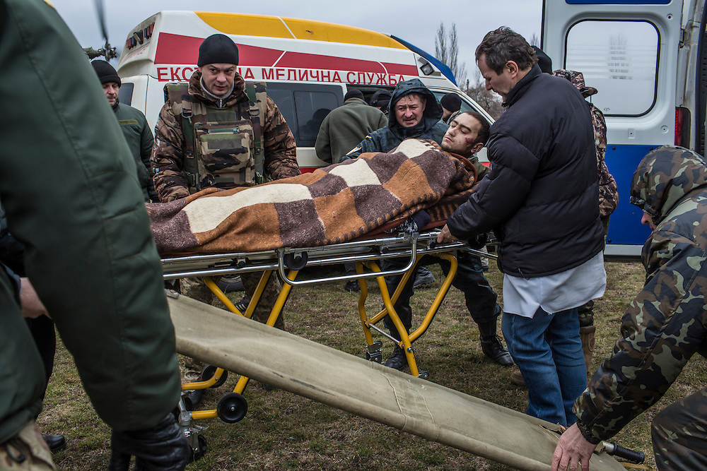 ARTEMIVSK, UKRAINE - FEBRUARY 8, 2015: A wounded Ukrainian soldier is loaded onto a medevac helicopter on a sports field, which will take him and others to Dnipropetrovsk for treatment in Artemivsk, Ukraine. Fighting between pro-Russia rebels and Ukrainian forces has dealt steady casualties to Ukrainian fighters and civilians. CREDIT: Brendan Hoffman for The New York Times