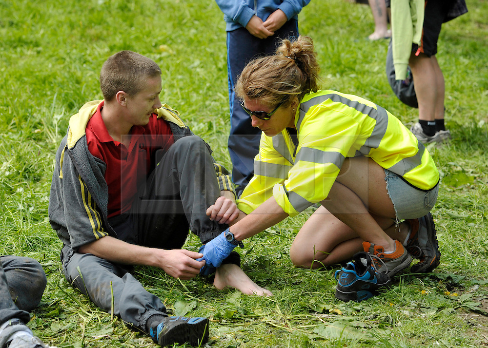 © Licensed to London News Pictures. 27/05/2013. Brockworth, Gloucestershire, UK.  A minor injury at the annual Cheese Rolling event.  Police had advised organisers including the local cheese supplier that they might be liable for any mishaps and the event this year was unofficial.  One man suffered a serious leg injury.  27 May 2013..Photo credit : Simon Chapman/LNP