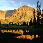 Hesperus Peak, reflected in high altitude pond at sunset. San Juan National Forest, Colorado
