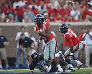 Mississippi running back I'Tavius Mathers (5) scores on a 10 yard run past Southeast Missouri State's Cantrell Andrews (24) at Vaught-Hemingway Stadium in Oxford, Miss. on Saturday, September 7, 2013. Ole Miss won 31-13.