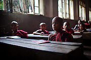 Novice monks gather for a math class. They are given a tradtional education, as well as learning the ways of the Buddhist life.