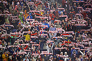 SHOT 3/22/13 7:06:33 PM - United States soccer fans hold up team scarves during player introductions before a game against Costa Rica in their World Cup qualifying game at Dick's Sporting Goods Park in Commerce City, Co. on Friday March 22, 2013. The U.S. won the game 1-0 in a spring blizzard that blanketed the pitch and fans in the stadium in snow. (Photo by Marc Piscotty / © 2013).