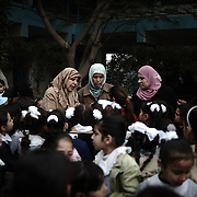Palestinian teachers speak with their students at UNRWA's (UN Relief and Works Agency) primary school in Beit Lahia in the northern Gaza Strip on January 24, 2009. Some 200,000 Gaza children returned to school for the first time since Israel's offensive, many having lost family members, their home and their sense of security. The main UNRWA centre and several schools were destroyed by Israeli bombing during the 22-day war.