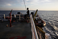 Italy: MSF Dignity1: A MSF member of the Dignity1 crew does exercise early in the morning on the forecastle deck of the Dignity1 on August 23, 2015. Alessio Romenzi