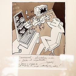 """Dessin de Serguei paru dans le Monde et dedicace par l'auteur. """"Comment gouverne... Emmanuel Hoog"""", president de l'Institut National de l'Audiovisuel (INA). Bry-Sur-Marne, France. 7 janvier 2010. Photo : Antoine Doyen pour Challenges. Tous droits reserves."""