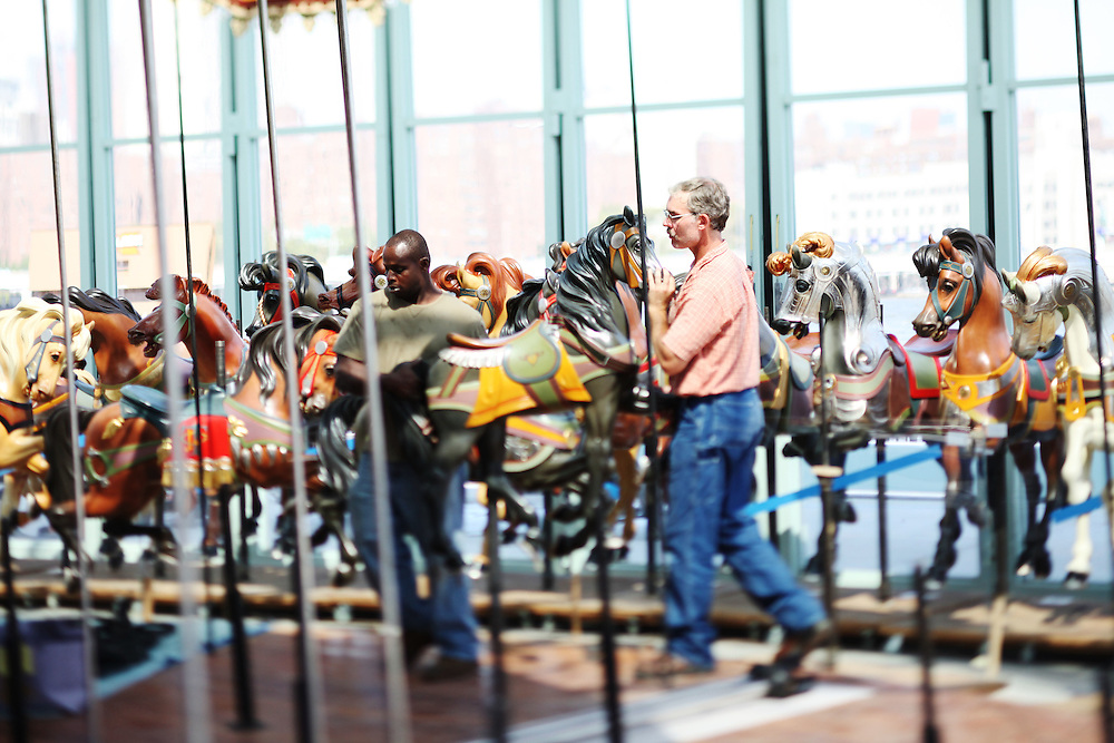 The construction crew begins to install horses in Jane's Carousel on September 2.  The carousel is the work of DUMBO resident Jane Walentas, who donated the piece to the Brooklyn Bridge Park after years of restoring the carousel to its original splendor. ..CREDIT: Daniella Zalcman for The Wall Street Journal.SLUG: NYJANES