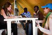 Tunisia: UNHCR Goodwill Ambassador, Angelina Jolie meets with 26 year old Veronica from Ivory Coast and Nanig Karekinian, a UNHCR Protection Officer at Shousha Camp near the Tunis-Libya border.<br /> <br /> Veronica arrived at the camp on 29th March, fleeing fighting in Tripoli, Libya. She worked as a baby sitter and cleaner for 3 families in the city, earning approximately &euro;250 per month.<br /> <br /> Veronica is the only female Ivorian in a camp of almost 9000 refugees. She flew from Ivory Coast to Tripoli on the promise of earning better money and prospects that would otherwise be possible at home in Abidjan. Upon arrival she was forced to work as a cleaner for a family that demanded she work from 08.00am until 02.00am the following day. She says she suffered physical abuse from various members of the family and was finally held captive in the family house. She managed to escape to the Burkini Faso embassy who directed her to a Ivory Coast consulate who managed to recover her passport from the family but little else in the way of possessions.<br /> <br /> She eventually found other employment with better families, but she says when the bombing started i Tripoli she heard on the radio that Gaddafi was using African mercenaries and they were being attacked and killed by Libyans.<br /> <br /> She says she was living with her boyfriend when their house was attacked by Libyans. Her boyfriend decided to stay but fearing the worse she decided to leave immediately, leaving all her possessions and found a bus with fellow migrant African's on board heading tot he border.<br /> <br /> She now resides in a part of the camp with some 80-90 Ivorian men, who she says, look after her and ensures her security in the male dominated camp.<br /> <br /> Veronica says she needs clean water to take with her medication, she complains that the water provided in the camp is not fit for drinking.<br /> <br /> Yesterday she spoke with her 4 year old daughter, Ida Immaculee, who lives with her ex-husband in Abidjan. She says her daughter was crying and saying that she is