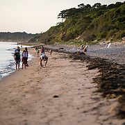 CAPE CHARLES, VA - JUNE 20: Tourists hunt for shells along the beach at Sunset Beach on Friday, June 20th, 2014 near Cape Charles, Va. (Photo by Jay Westcott/For The Washington Post)