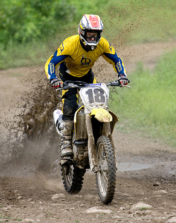 THOMASTON, CT-  6 June 2010-- New England professional motocross legend Jim Meenan, who won 29 New England Motocross Championships, kicks up some roost while enjoying a day of trail riding at the U.S. Army Corps of Engineers Thomaston Dam in Thomaston, CT. The dam offers over 800 acres of public land use including trail bike riding. The riding season is open from May 1 through October 14.  (Photo by Robert Falcetti)