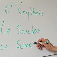 HG centre de formation, Rue de Lyon.<br /> <br /> French language class for asylum seekers, with a  teacher on reinsertion.