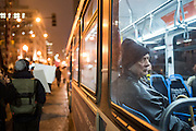 A man riding a CTA bus, watches as demonstrators march in protest of Donald Trump's Inauguration in River North on January 20, 2017.