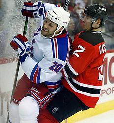 March 19, 2008; Newark, NJ, USA;  New Jersey Devils defenseman Vitaly Vishnevski (2) hits New York Rangers right wing Fredrik Sjostrom (20) during the first period at the Prudential Center in Newark, NJ. Mandatory Credit: Ed Mulholland-US PRESSWIRE