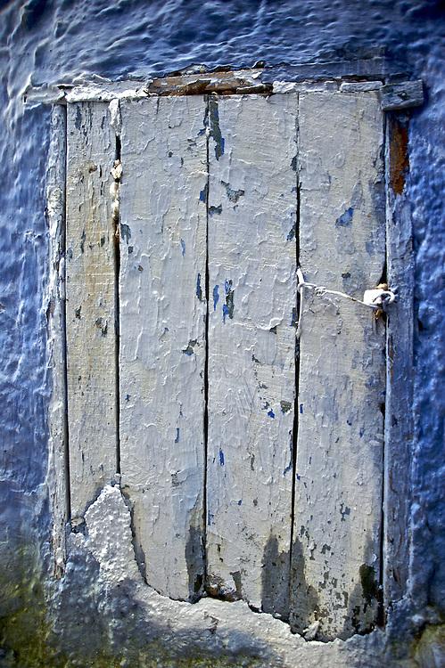 A door in the narrow alleyways of Chaouen, Morocco.