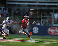 Ole Miss' Randall Mackey (1) gets away from Central Arkansas' Seth Allison (12) at Vaught-Hemingway Stadium in Oxford, Miss. on Saturday, September 1, 2012.