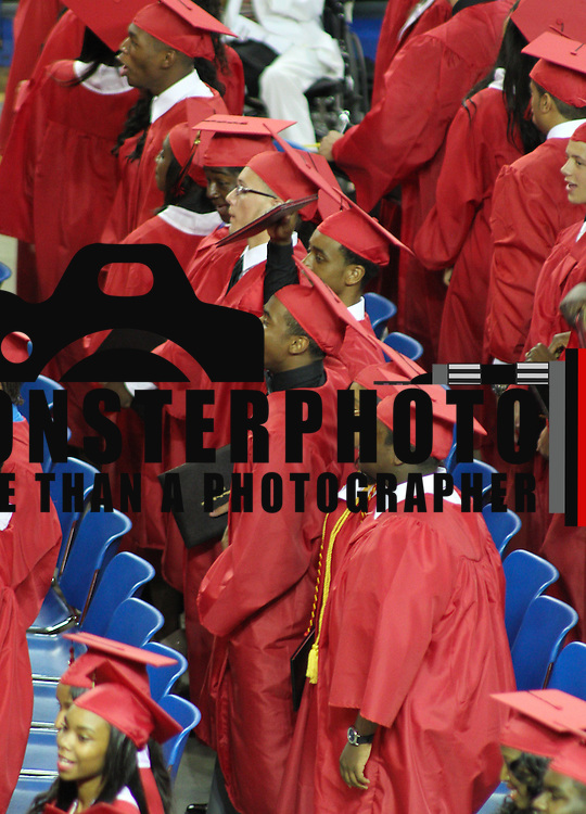 06/06/13 Newark DE:  William Penn High School students celebrate during the final moment of William Penn commencements exercises Thursday, June 6. 2013, at The Bob Carpenter Center in Newark Delaware.
