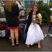 """CeCe takes her lasat smoke as a """"free woman"""" while waiting for her groom Crazy to return with their minister. They have their homeless street wedding amongst friends at the Salmon Springs Fountain.."""