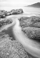 High key black and white of wave action along Fourth Beach, Olympic National Park, Washington
