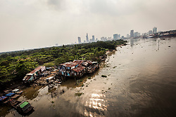 Substandard dwellings seen from Thu Thiem bridge, Ho Chi Minh City, Vietnam, Southeast Asia