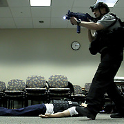 Master Sergeant Adam B. Ringle (RIGHT) perform a secure and rescue scenario during an Active Shooter workshop Sunday, Mar 16, 2014 Christina Hospital in Newark Delaware.