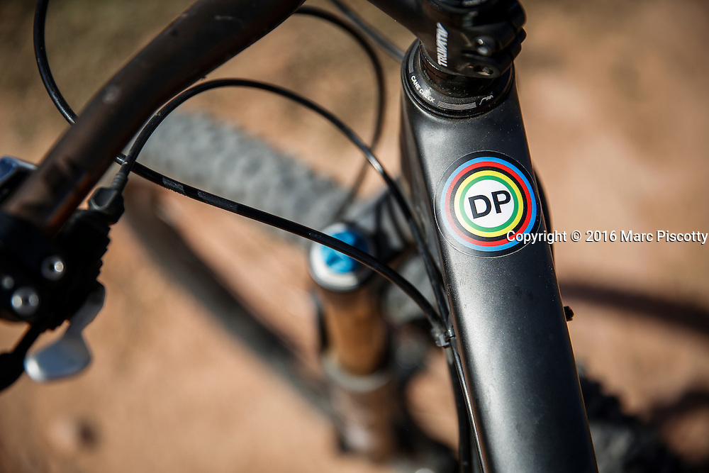 SHOT 10/14/16 12:27:25 PM - A sticker commemorating the life of photographer Doug Pensinger on Marc Piscotty's bike. The White Rim is a mountain biking trip in Canyonlands National Park just outside of Moab, Utah. The White Rim Road is a 71.2-mile-long unpaved four-wheel drive road that traverses the top of the White Rim Sandstone formation below the Island in the Sky mesa of Canyonlands National Park in southern Utah in the United States. The road was constructed in the 1950s by the Atomic Energy Commission to provide access for individual prospectors intent on mining uranium deposits for use in nuclear weapons production during the Cold War. Four-wheel drive vehicles and mountain bikes are the most common modes of transport though horseback riding and hiking are also permitted.<br /> (Photo by Marc Piscotty / &copy; 2016)