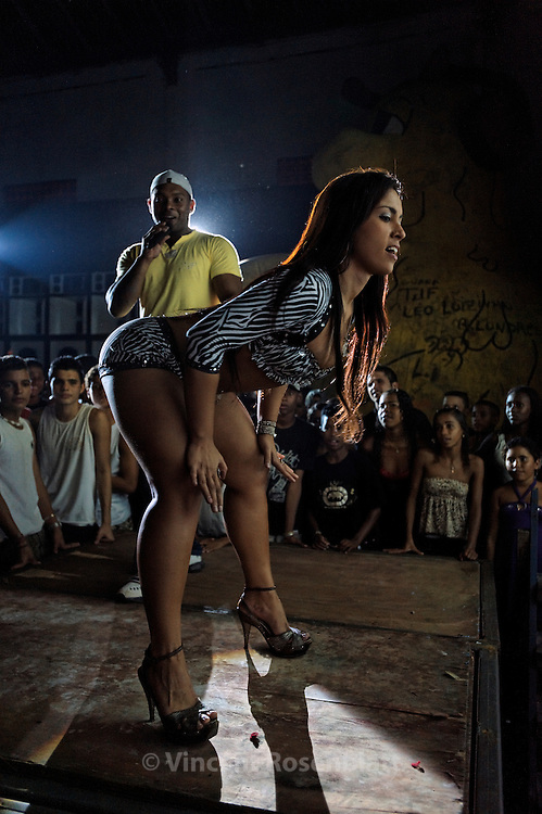 "Show with MC David Bolado's  (""nervy"")  with his dancer Rose Bombom, during the  Baile Funk on sunday night at Club 18, in the borough of Olaria, by the entry of the Complexo do Alemão's favelas."