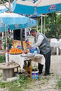 Turkey, Antalya, a Turkish man squeezing orange juice