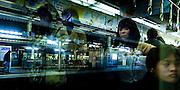 Train passengers and window reflections. Japan.