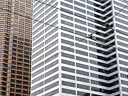 streetcar power lines mimic the lines of the Seattle high rise buildings in downtown Seattle, Washington, USA