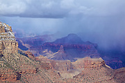 Photograph by Leandra Lewis Melgreen from a lookout point on the Grand Canyon Rim trail shows the rain patterns looming over n the distance over the South Rim Grand Canyon National Park in the winter