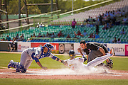 SAN JUAN, PUERTO RICO FEBRUARY 4: Infielder for  Venezuela, Ehire Adrianza, slides into home during the game against the Dominican Republic  on February 4, 2015 in San Juan, Puerto Rico at Hiram Bithorn Stadium(Photo by Jean Fruth)