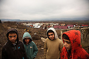 Boys in the Roma settlement in Ostrovany, Slovakia. L-R, Ferko (12), Lukas (9), Lubomir Kaleja (12) and David Kotler (12)