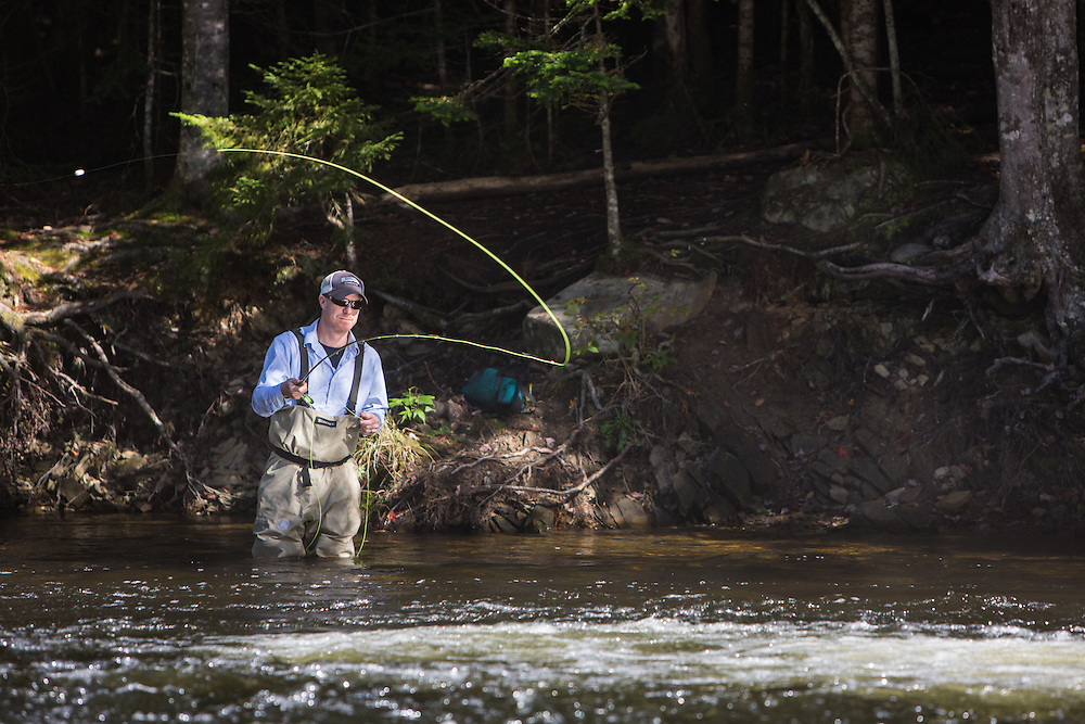 male fly fisherman on the trophy stretch of the upper connecticut river in northern New Hampshire