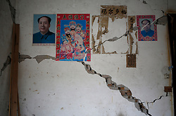 Portraits of former Chinese leader Mao Zedong is seen on a damaged wall of a home in Longmen Village of Lushan County, Sichuan Province, China, 22 April 2013. The Lushan Earthquake in Sichuan Province on 20 April 2013 resulted in 186 people dead, 21 missing, 11248 injured. About 1.72 million people were affected by the quake, while an initial estimate by the International Red Cross on Saturday put the number needing emergency shelter, water and food at 120,000. The China Earthquake Administration (CEA) recorded a magnitude 7.0 earthquake, while the US Geological Survey said it had measured 6.9.