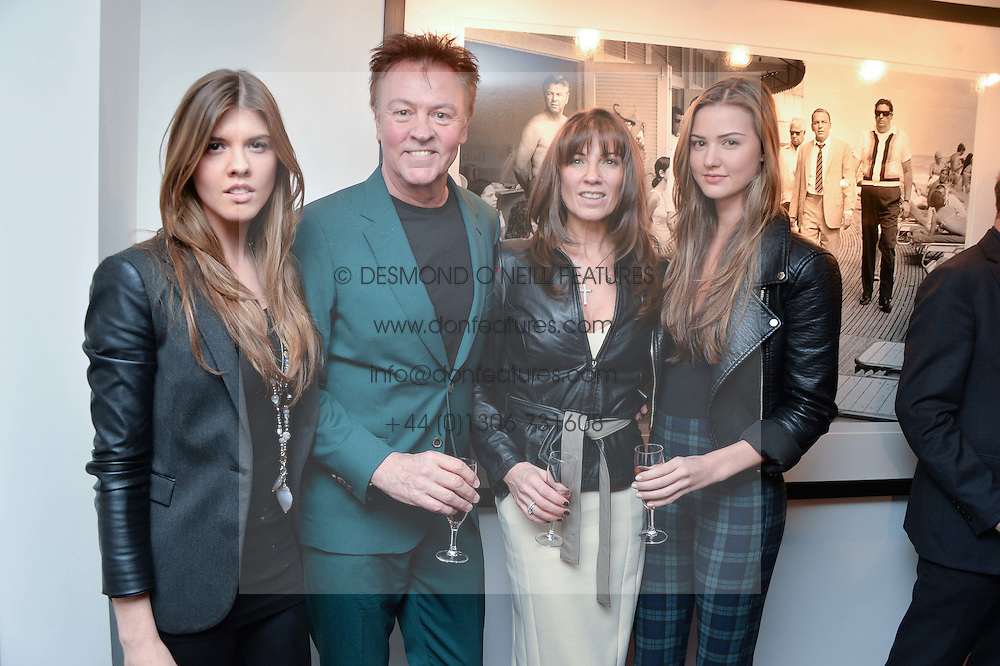 Left to right, LEVI YOUNG, PAUL & STACEY YOUNG and LAYLA YOUNG at a private view of photographs 'Terry O'Neill-The Best Of' held at The Little Black Gallery, 13A Park Walk, London on 16th January 2014.