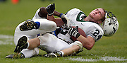 Grant's Jaron Moody (1) drags Tigard's Travis Howe (24) down to the field hard enough to dislodge his helmet. Tigard beat Grant 34-12...