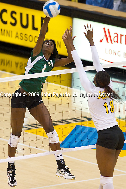 Dominique Olowolafe(1) hits for Cal Poly with Michelle Osunbor(18) blocking in the Big West Conference game against Long Beach State at the Walter Pyramid, Long Beach CA, Saturday Oct. 3, 2009.