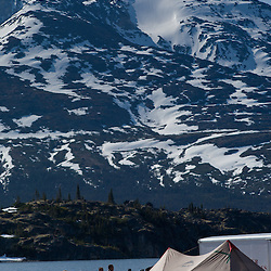 Lakeside campground under a mountain, Yukon Territory, Canada