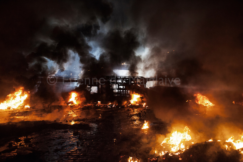 Violent clashes opposed protesters and riot police on Hrushevskoho street with baricades and police trucks set on fire in Kiev, 22 January 2014.