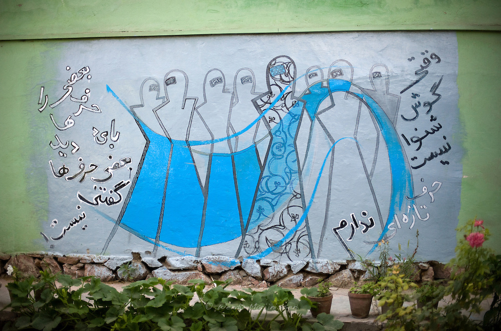An artwork by Shamsia Hassani in the 'Venue' restaurant. With no possiblility to go outside in the city to do her graffiti, Shamsia finds walls in private spaces to put her artwork on. The female figures in burqa are a symbol she uses to talk about women's rights and the problems women in her country face. Kabul, Afghanistan, 2012