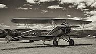 """1929 Waco CTO """"Taper Wing"""" and 1928 Waco GXE at WAAAM."""