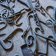 Iron hooks from Blacksmith demonstration. Conner Prairie Interactive History Park provides family-friendly fun for all ages in Fishers, Indiana, USA. Founded by pharmaceutical executive Eli Lilly in the 1930s, Conner Prairie living history museum now recreates life in Indiana in the 1800s on the White River and preserves the William Conner home (listed on the National Register of Historic Places).