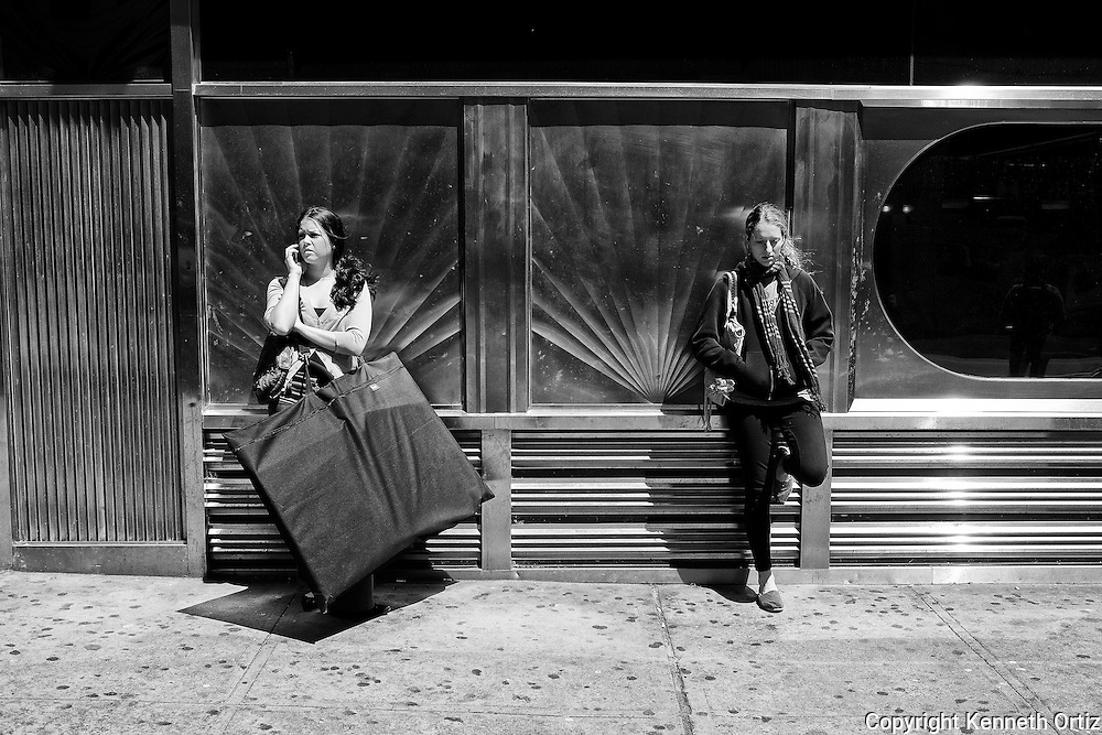 Two women stand by the Empire Diner on 34th Street and 8th Avenue in New York City.