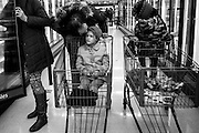Shopping can be experience when the entire family goes. Savannah leads the way picking up what they need, while Keith jokes around with the kids who are both in their own worlds.