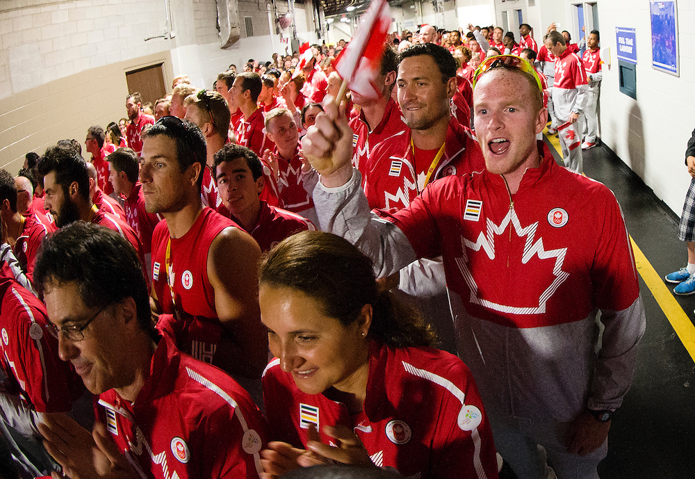 Athletes wait to be called into the stadium during the opening ceremonies of the Pan Am Games at the Rogers Centre in Toronto on July 10, 2015.