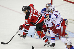 May 25, 2012; Newark, NJ, USA; New York Rangers goalie Henrik Lundqvist (30) makes a save on a tip by New Jersey Devils left wing Alexei Ponikarovsky (12) during the second period in game six of the 2012 Eastern Conference finals at the Prudential Center.