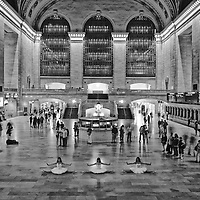 Three ballerinas in white tutu dancing in Grand Central Station at night. Dancers: Brittany Cavaco, Abigail Sartin and Sage Engle-Laird.