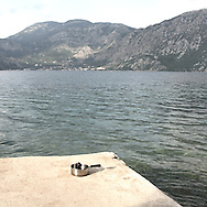On Perast beach. There are several arguments about the derivation of the name  &quot;Montenegro&quot;, one of these relates to dark and deep forests  that once covered the Dinaric Alps, as it was possible to see them from the sea. <br />