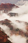 The clouds begin to part after a period of heavy rains and low-visibility at the Grand Canyon.