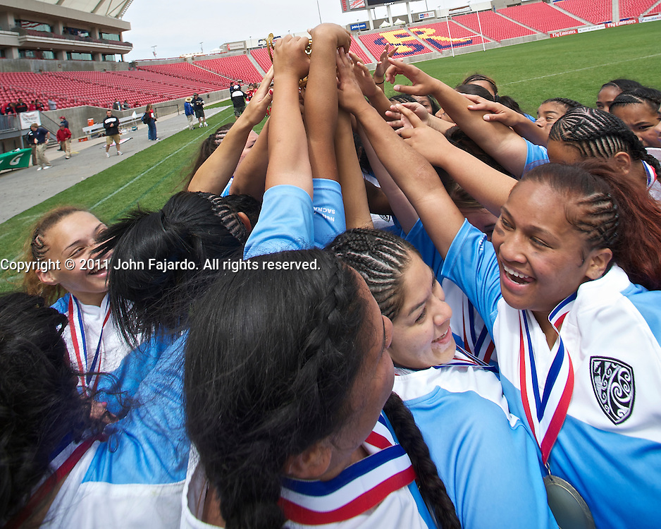 Sacramento Amazon's reach for the cup after defeating the Fallbrook Warriors in the USA Rugby U19 Girls National Championship match at Rio Tinto Stadium, Sandy Utah, Sunday May 23, 2010.