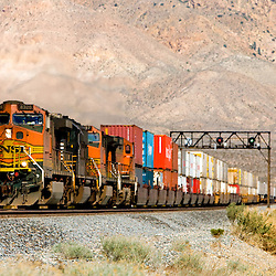An eastbound BNSF Railway intermodal train approaches Mojave, CA, descending the grade off the Tehachapi Mountains.